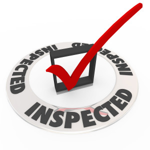 The word Inspected around a check mark and box to illustrate home inspection, or personal evaluation, review or assessment